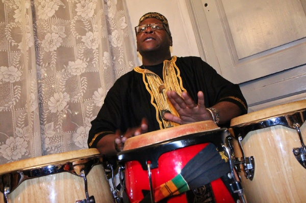 <p><p>Baba Garland M. Franklin, a percussionist with Temple University's Pan-African Studies Community Education Program (PASCEP), drums at the Johnson House Kwanzaa celebration. (Kimberly Paynter/WHYY)</p></p>