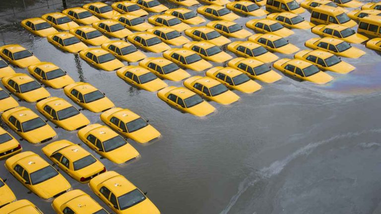 Flooded taxis in Hoboken the morning after Superstorm Sandy hit NJ/NY. (AP File Photo/Charles Sykes)