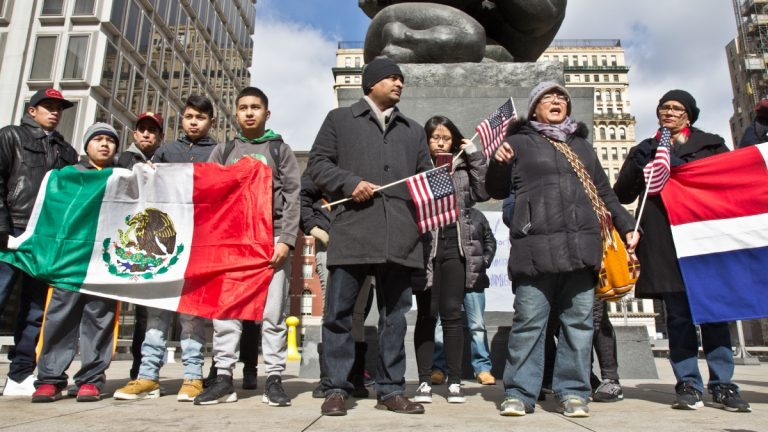 Immigrants who participated in A Day Without Immigrants gather a Thomas Paine park for a rally. (Kimberly Paynter/WHYY)