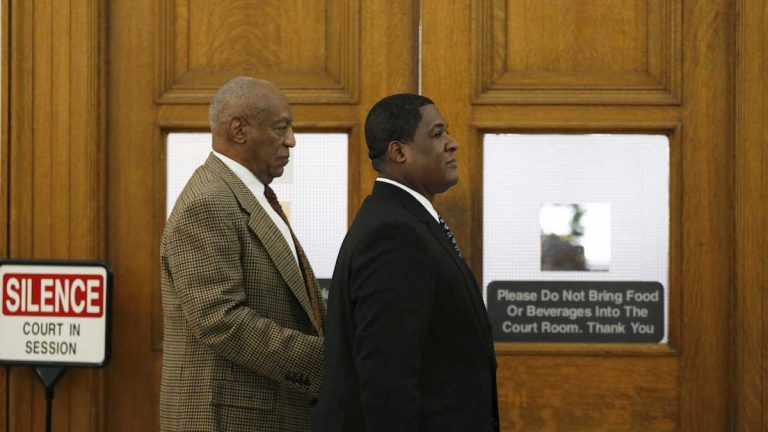 Bill Cosby, left, leaves the courtroom during a break in the pretrial hearing in his sexual assault case at the Montgomery County Courthouse in Norristown, Pa. (David Maialetti/The Philadelphia Inquirer via AP, Pool)