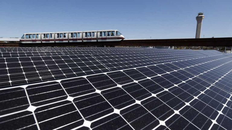 Solar panels on the roof of the building supplying energy to the AirTrain at Newark Liberty International Airport soak up the rays. (AP file photo)