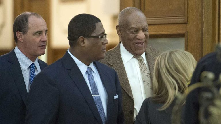 Bill Cosby leaves the courtroom with the help of an aide flanked by lawyer Brian McMonagle (far left) with fellow counsel Angela Agrusa (right) during a break at the Montgomery County Courthouse in Norristown