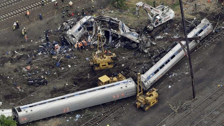 Emergency personnel work at the scene of a deadly train derailment, Wednesday, May 13, 2015, in Philadelphia. The Amtrak train, headed to New York City, derailed and crashed in Philadelphia killing at least six people and injuring dozens of others. (Patrick Semansky/AP Photo)
