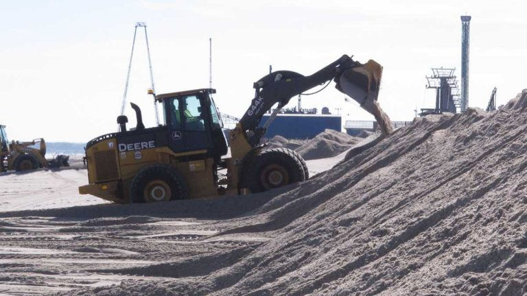 File photo showing crews building up a dune in Ortley ahead of a Nor'Easter. (Wayne Parry/AP Photo)