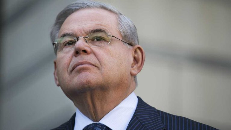 U.S. Sen. Bob Menendez waits to speak outside federal court, Thursday, April 2, 2015, in Newark, N.J. Menendez, the top Democrat on the U.S. Senate Foreign Relations Committee, was indicted on corruption charges, accused of using his office to improperly benefit an eye doctor and political donor. (John Minchillo/AP Photo)