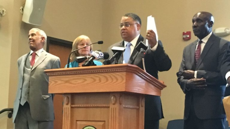 During a February press conference, Rev. Christopher Bullock holds a letter to U.S. Attorney General Jeff Sessions asking for a federal investigation into Delaware prisons. (Mark Eichmann/WHYY)
