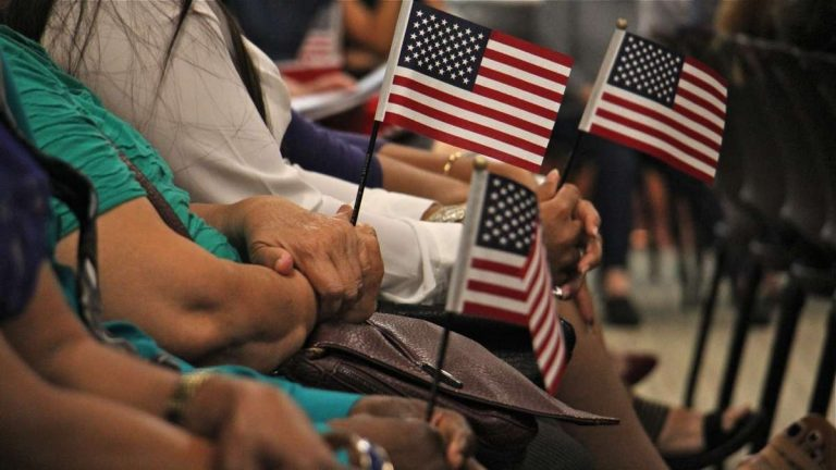 New citizens wait to take the oath of allegiance during a naturalization ceremony in Philadelphia. (Emma Lee/WHYY, file)