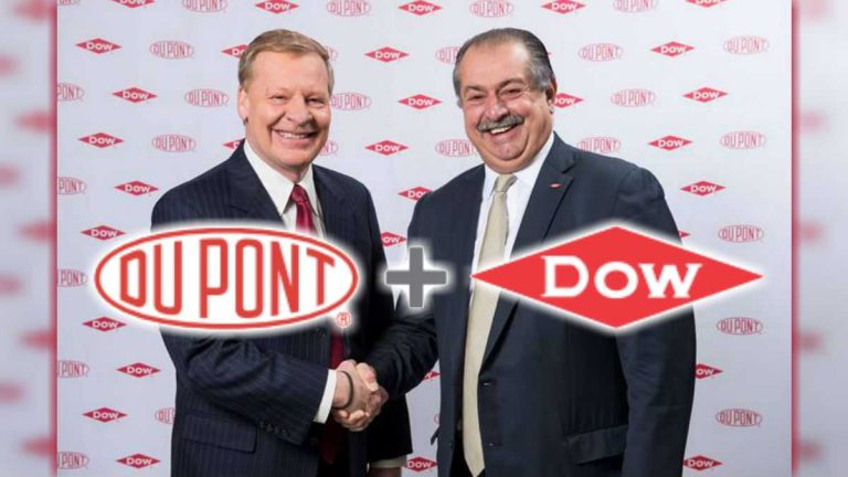 DuPont CEO Ed Breen shakes had with Dow Chemical CEO Andrew Liveris after announcing their companies' merger into DowDuPont. (photo courtesy DuPont)