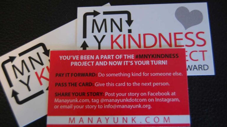 The Manayunk Development Corporation printed business-sized cards explaining the MNYKINDESS Project. Check out Emily Brooks' story for more information. (Emily Brooks/for NewsWorks)