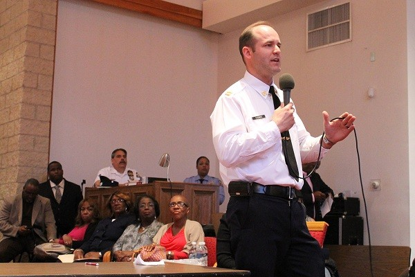 Capt. John Fleming of the 14th Police District speaking to residents at a meeting in May. (Matthew Grady/for NewsWorks, file)