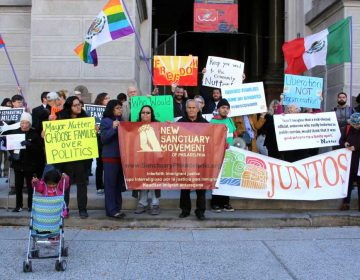 Protesters gather at City Hall in support of undocumented immigrants. (Emma Lee/WHYY)