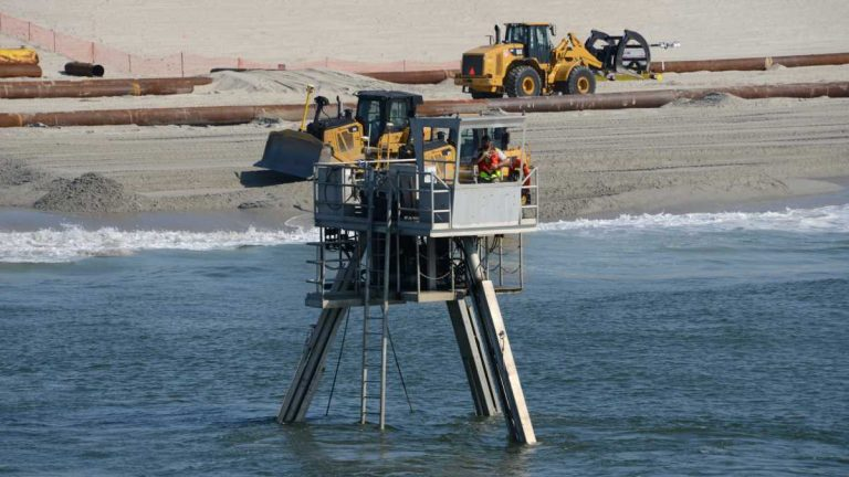 A Coastal Research Amphibious Buggy (CRAB) surveys the surf area of Brant Beach, NJ during a restoration project in June of 2013. (Photo by USACE)