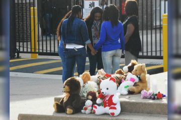 Students gather outside Howard High following the death of Amy Joyner-Francis in April 2016. (File/WHYY)
