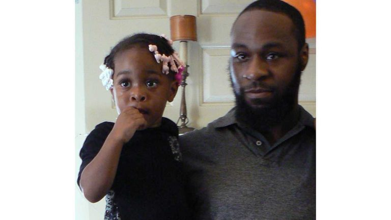 Tyree Carroll holds his daughter.(Carroll family photo)