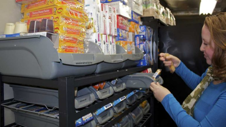 Jenna Klaus stocks the food pantry at Montgomery County Community College's West campus in Pottstown in this 2015 file photo.  (Laura Benshoff/WHYY)