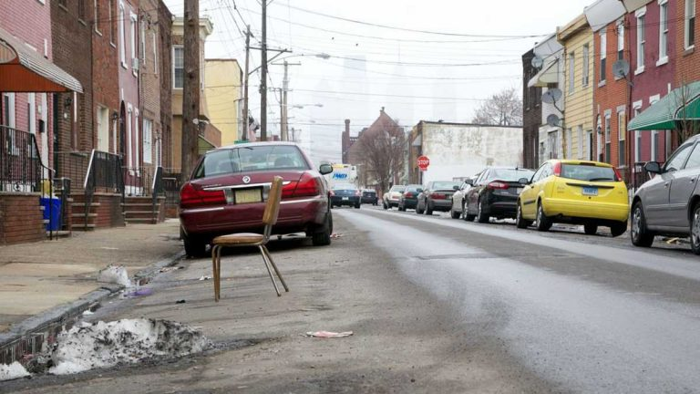 Cars are parked along a street in Philadelphia. (Nathaniel Hamilton/for NewsWorks)