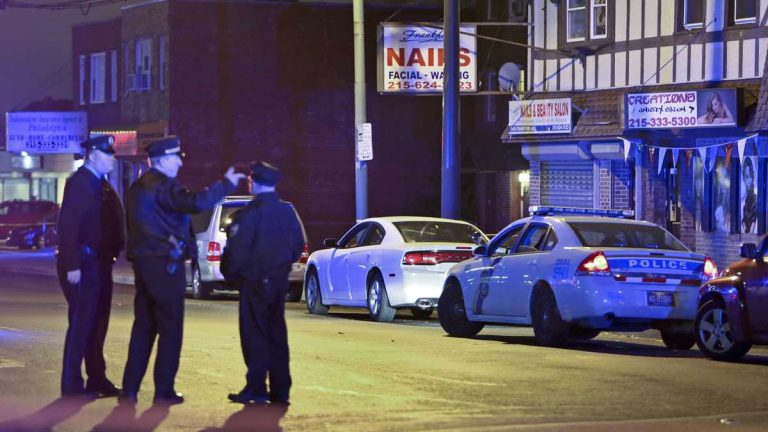 Investigators gather at the crime scene in the Mayfair section of Philadelphia, Monday Dec. 15, 2014, after an officer fired their weapons at a man. (AP File Photo/Joseph Kaczmarek)