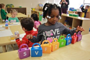 Makayla Grant gets busy on her first day of preschool at SPIN-Parkwood on Jan. 4, 2017. (Emma Lee/WHYY, file)