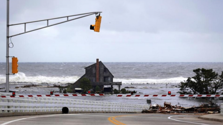 A lone home stood near the Mantoloking Bridge in Mantoloking after Superstorm Sandy's storm surge inundated the area in late October 2012. (Associated Press photo)
