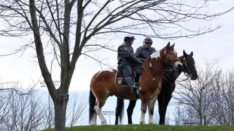Pennsylvania State Police on horses outside Beaver Stadium before an NCAA college football game between the Penn State and the Michigan State in State College, Pa. (AP File Photo/Gene J. Puskar)