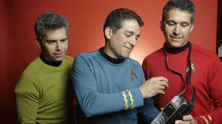 Members of the Final Frontier Medical Devices team geeked out in Star Trek gear, with the fictional device that inspired the Qualcomm Tricorder XPRIZE. From left: brothers George, Basil and Gus Harris. (Not pictured: Phil Charron, Julia Harris, Andy Singer and Ed Hepler.) (Photo courtesy of XPRIZE)