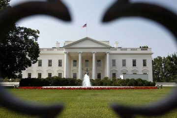 The White House can be seen through a fence