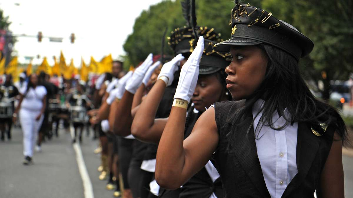 The Modern Legends Drill Team of American Legion Post 224 perform in the Philadelphia Labor Day parade. (Emma Lee/WHYY)