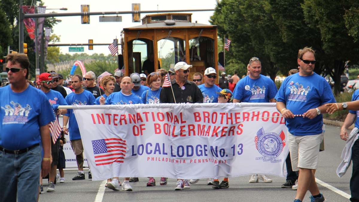 Members of the International Brotherhood of Boilermakers march in the Labor Day parade down Columbus Boulevard in Philadelphia. (Emma Lee/WHYY)