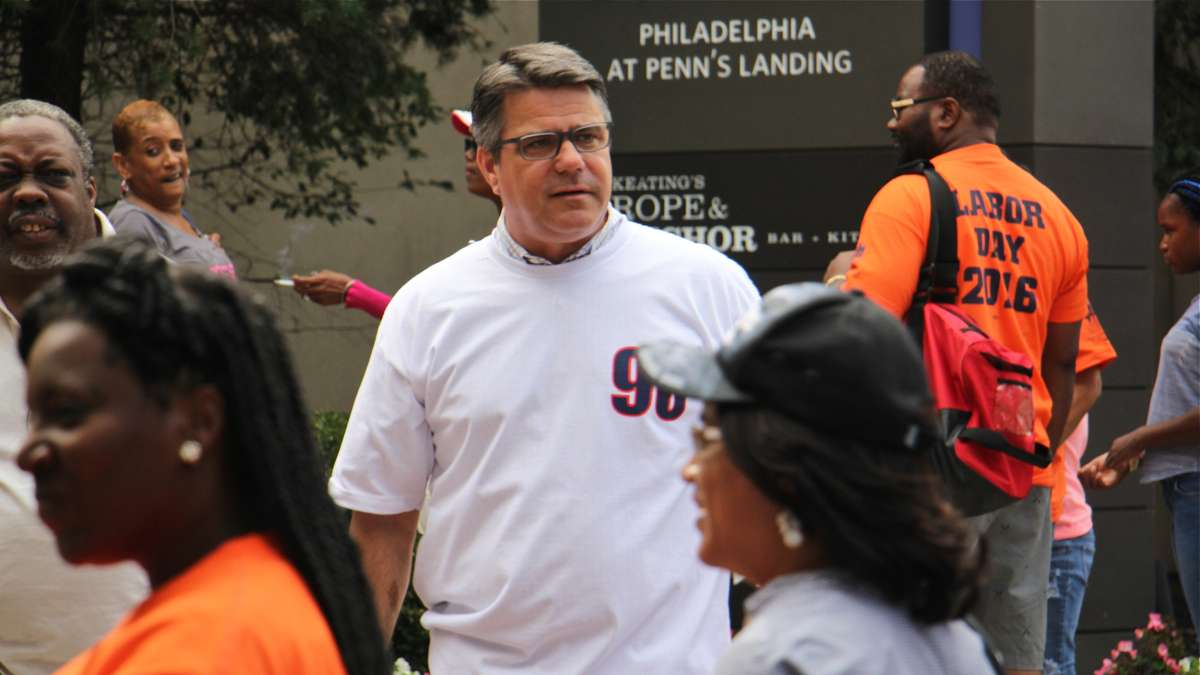 Philadelphia City Councilman Bobby Henon wears a Local 98 T-shirt at the Labor Day parade. Henon's office at City Council was searched by the FBI. (Emma Lee/WHYY)