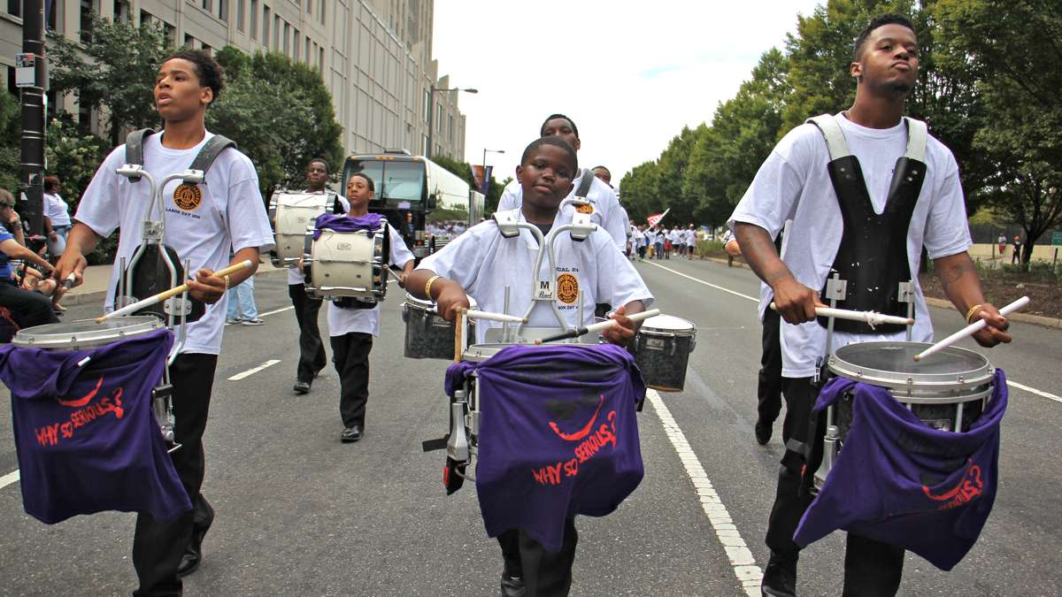 Drummers for Transport Workers Local 234 bang out a rhythm in the Philadelphia Labor Day parade. (Emma Lee/WHYY)