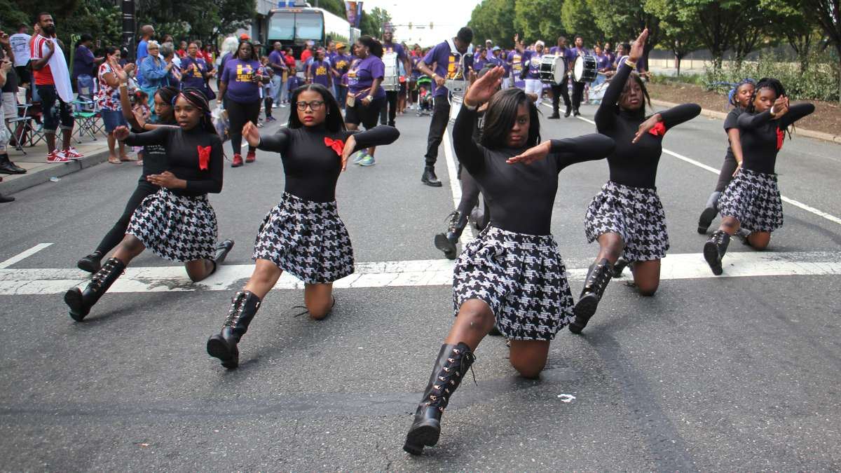 Members of the Finest Drill Team and Drum Corps perform in the Philadelphia Labor Day parade, leading the Service Employees International Union. (Emma Lee/WHYY)