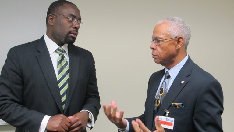 DCA Commissioner Richard Constable and OCEAN Inc. President Ted Gooding discuss the Landlord Rental Repair Program at the Housing Recovery Center in Freehold, N.J.  (Phil Gregory/WHYY)