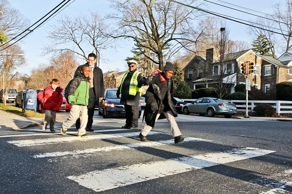 "<p><p>A crossing guard at the corner of Conrad St. and Midvale Ave. since 2004, Larry Abney says, ""When I started here, they didn't want to stop for you to cross the kids. If you have to be at work at 8, why do you leave at 5 of?"" (Kimberly Paynter/WHYY)</p></p>"