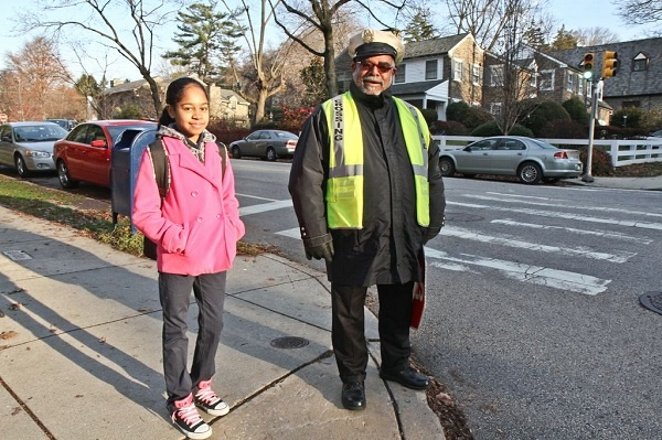 <p><p>Larry Abney, a crossing guard at Mifflin Elementary School, has become an East Falls neighborhood staple since he started working at a busy intersection eight years ago. (Kimberly Paynter/WHYY)</p></p>