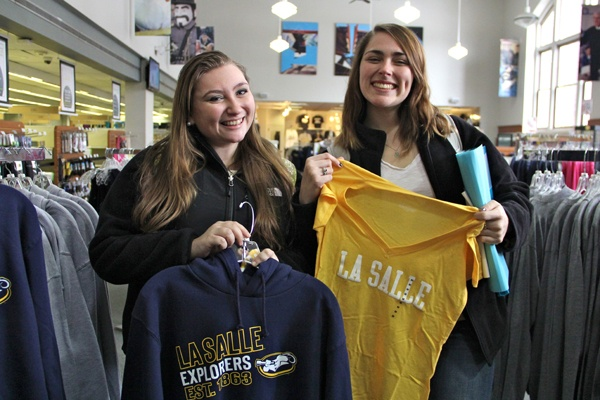 Heather Mengert and Erika Schellinger stock up on La Salle gear at the campus bookstore.