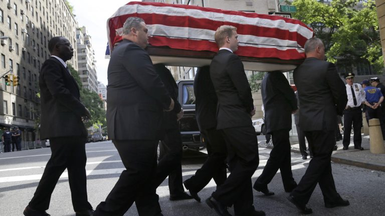 The casket containing the body of U.S. Sen. Frank Lautenberg is carried into the Park Avenue Synagogue in New York City on Wednesday. (AP Photo/Seth Wenig)