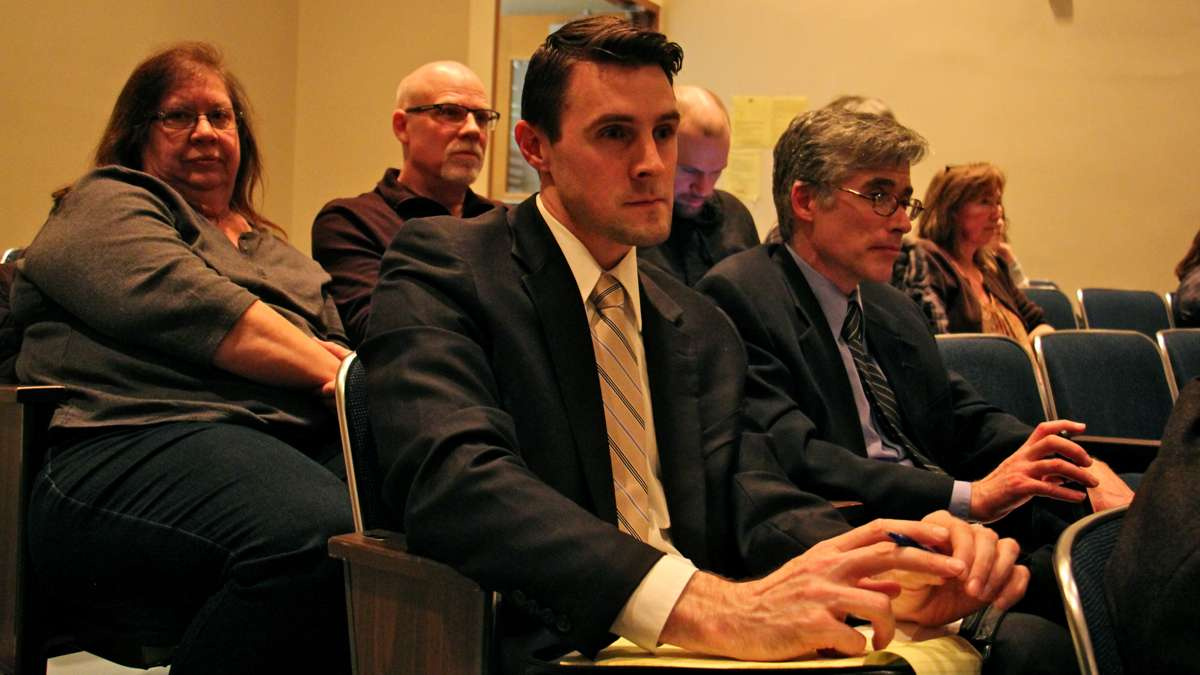 Lawyers for the plaintiff in Doe vs. BASD Jeremy Samek (center) and Randall Wenger (right) listen to public testimony on a resolution to comply with demands that students be restrictied to using restrooms and locker rooms based on their biological sex. (Emma Lee/WHYY)