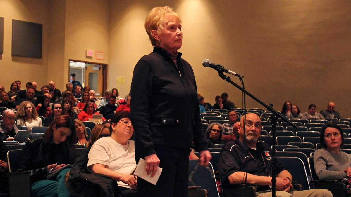 A resident criticizes the board for conducting ''a social eperiment that exposes our students to danger.'' (Emma Lee/WHYY)