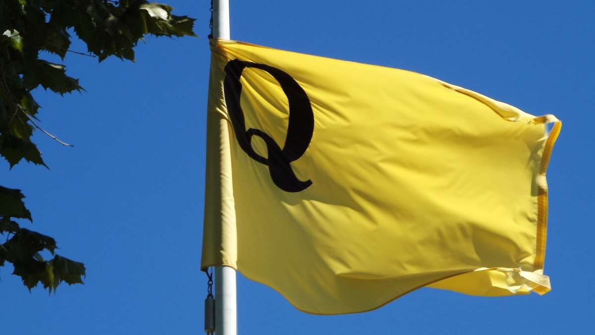 'Q' for quarantine.  The flag is an accurate replica of those used to signal ships into the docks for yellow fever inspection.