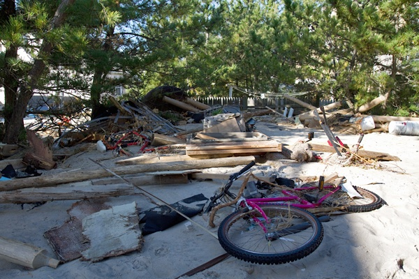 <p><p>Hurricane Sandy swept planks of wood and a bicycle into the backyard of a home in Beach Haven on Long Beach Island. (Lindsay Lazarski/WHYY)</p></p>