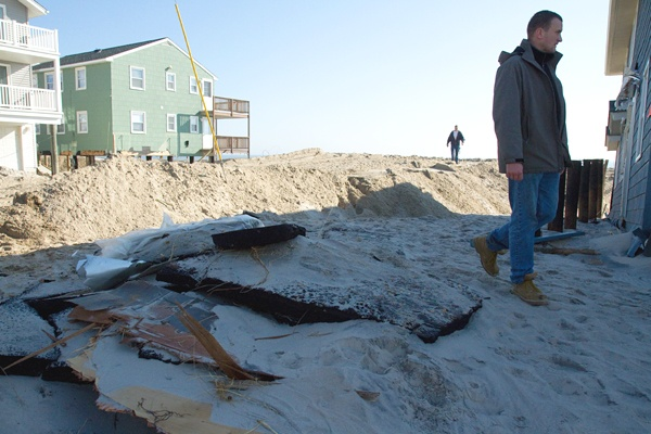 <p><p>Slabs of pavement ripped from a road, washed up next to a beachfront house on Long Beach Island after Hurricane Sandy. (Lindsay Lazarski/WHYY)</p></p>