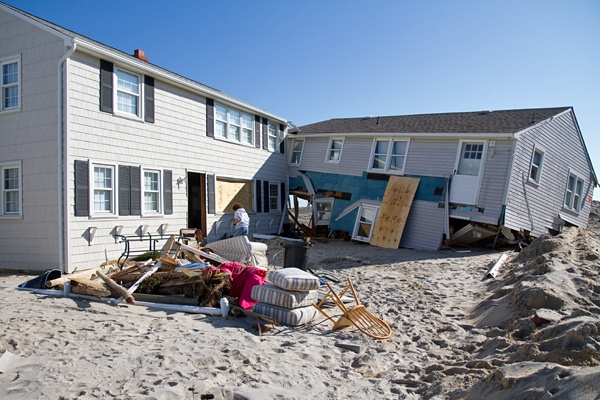 <p><p>Trish and Chandler Hosmer returned to their Long Beach Island home (left) on Sunday to begin to pick up the pieces after Hurricane Sandy. (Lindsay Lazarski/WHYY)</p></p>