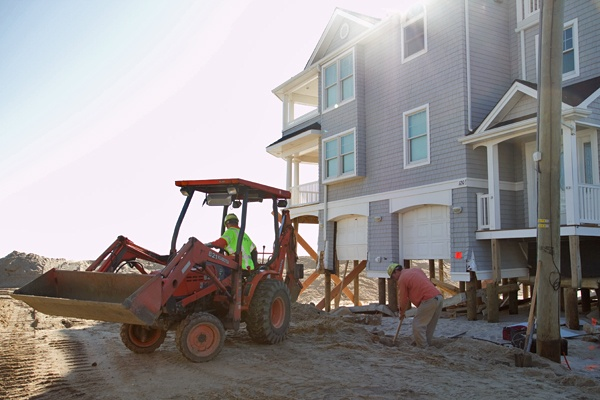 <p><p>Orlando Caceres (left) and Bill Callahan of PSEG dig through sand on Long Beach Island to disconnect a gas line of a beachfront property that will be demolished. (Lindsay Lazarski/WHYY)</p></p>