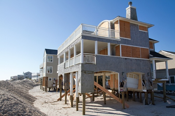 <p><p>A beachfront home is boarded up on Brighton Beach in Long Beach Island nearly two weeks after Hurricane Sandy made landfall on the New Jersey coastline. (Lindsay Lazarski/WHYY)</p></p>