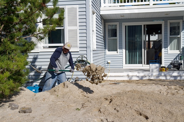 <p><p>Hank Ludington digs out his home from about four feet of sand on Long Beach Island after Hurricane Sandy. (Lindsay Lazarski/WHYY)</p></p>