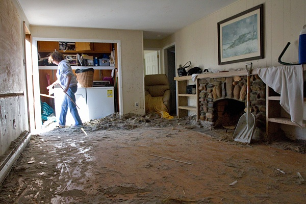 <p><p>Trish Hosmer removes pieces of broken furniture from her living room after Hurricane Sandy. (Lindsay Lazarski/WHYY)</p></p>