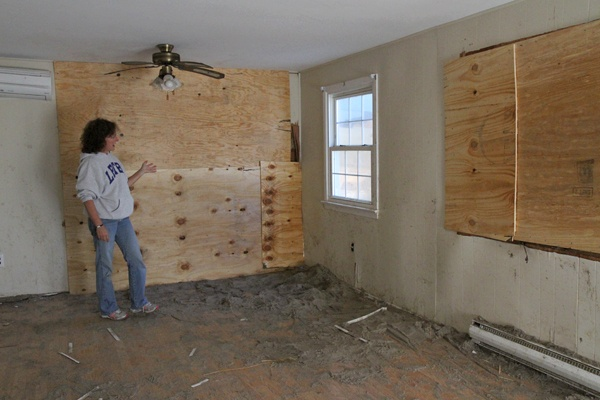 <p><p>Trish Hosmer shows where the neighbors' house crashed into her living room leaving a gapping whole. (Lindsay Lazarski/WHYY)</p></p>