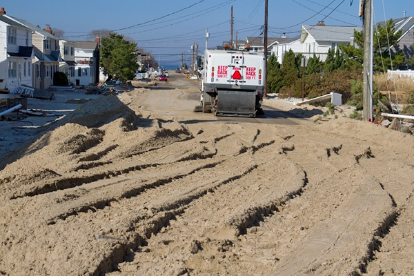 <p><p>Sand is cleared from a street on Long Beach Island nearly two weeks after Hurricane Sandy. (Lindsay Lazarski/WHYY)</p></p>