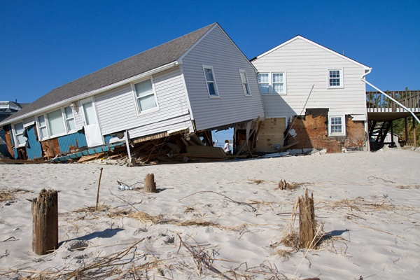 <p><p>Hurricane Sandy's high winds and intense waters sent a neighbor's home crashing into the Hosner's residence at Brighton Beach on Long Beach Island. (Lindsay Lazarski/WHYY)</p></p>