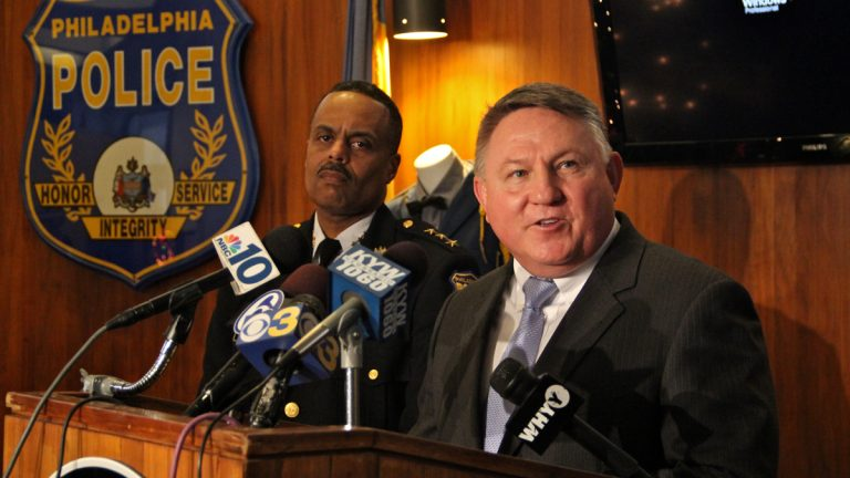 FBI Special Agent in Charge Ed Hanko (right) and Philadelphia Deputy Police Commissioner Richard Ross announce the arrest of a  fugitive suspected of brutally raping a woman in Philadelphia in 2010. (Emma Lee/WHYY)